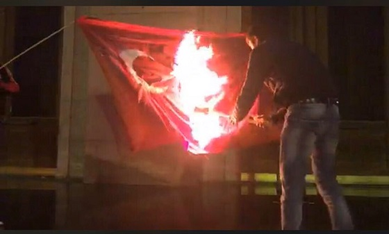 Young Armenians burn Turkish national flag at Liberty Square in Yerevan