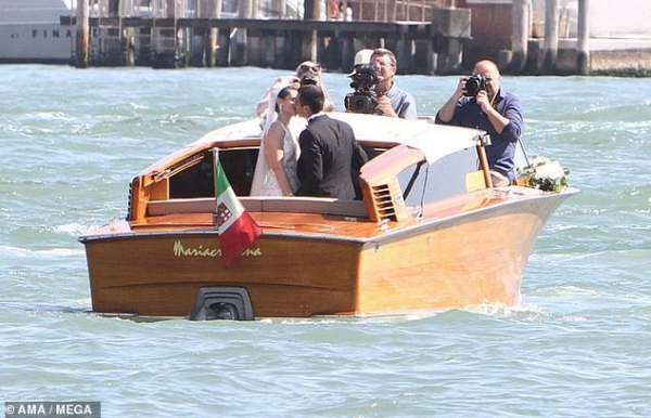 Henrikh Mkhitaryan kisses his beautiful bride Betty Vardanyan during romantic boat ride in Venice after getting married
